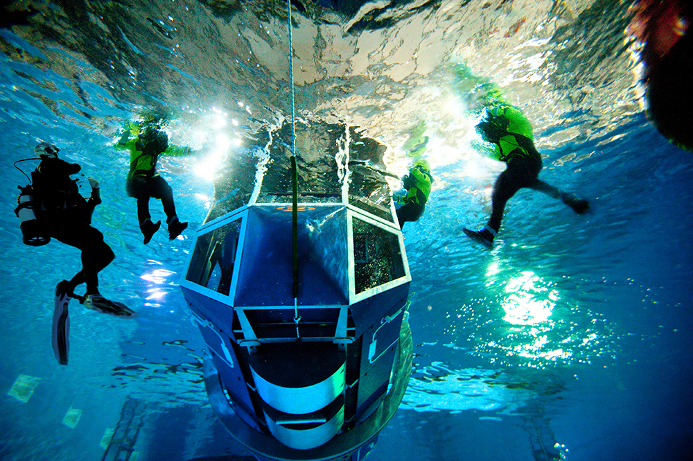 Offshore survival training being completed in Survivex's sea survival pool